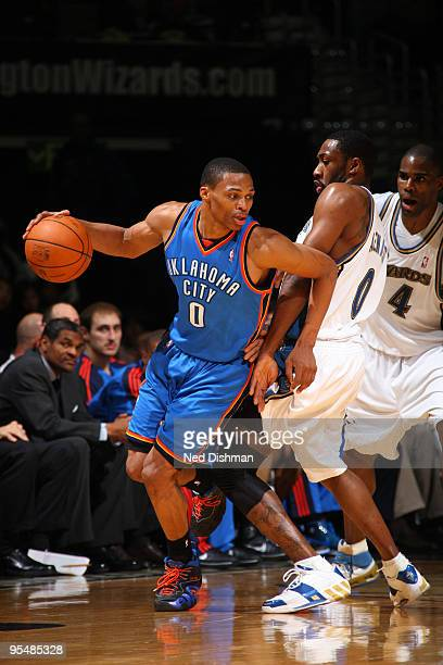 Russell Westbrook of the Oklahoma City Thunder drives against Gilbert Arenas of the Washington Wizards at the Verizon Center on December 29 2009 in...