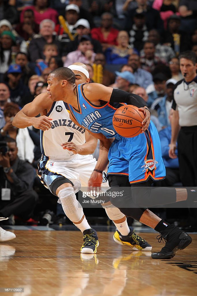 Russell Westbrook #0 of the Oklahoma City Thunder drives against Jerryd Bayless #7 of the Memphis Grizzlies on March 20, 2013 at FedExForum in Memphis, Tennessee.