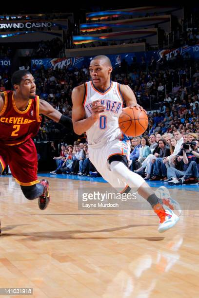 Russell Westbrook of the Oklahoma City Thunder drives against Kyrie Irving of the Cleveland Cavaliers on March 9 2012 at the Chesapeake Energy Arena...