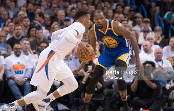 Russell Westbrook of the Oklahoma City Thunder drives around Kevin Durant of the Golden State Warriors during the second half of a NBA game at the...