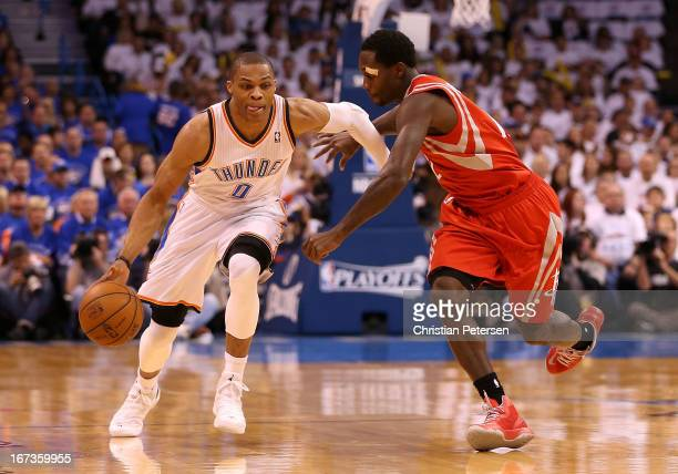 Russell Westbrook of the Oklahoma City Thunder drives the ball past Patrick Beverley of the Houston Rockets during the first quarter of Game Two of...