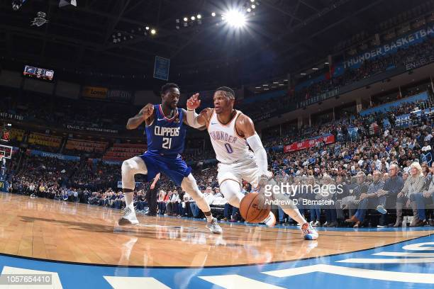 Russell Westbrook of the Oklahoma City Thunder drives to the basket around Patrick Beverley of the LA Clippers on October 30 2018 at Chesapeake...