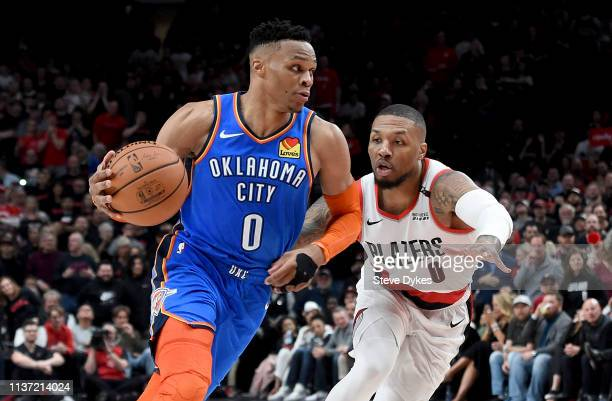 Russell Westbrook of the Oklahoma City Thunder drives to the basket on Damian Lillard of the Portland Trail Blazers during the second half of the...