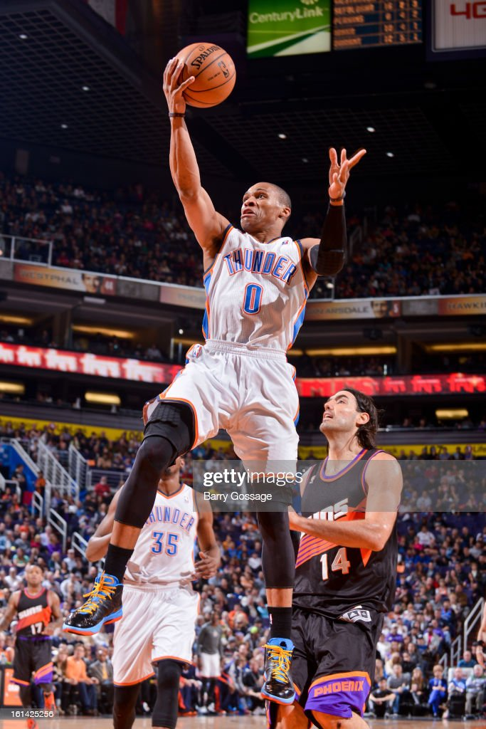Russell Westbrook #0 of the Oklahoma City Thunder drives to the basket against the Phoenix Suns on February 10, 2013 at U.S. Airways Center in Phoenix, Arizona.