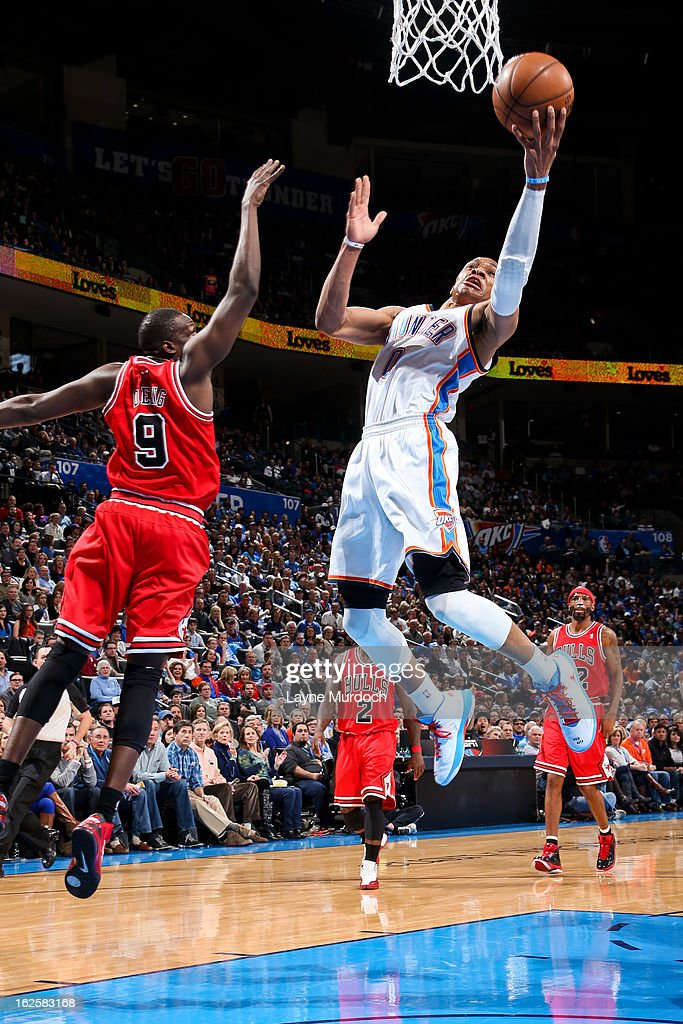 Russell Westbrook #0 of the Oklahoma City Thunder drives to the basket against Luol Deng #9 of the Chicago Bulls on February 24, 2013 at the Chesapeake Energy Arena in Oklahoma City, Oklahoma.