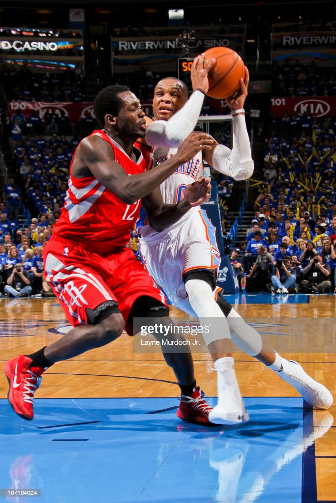 Russell Westbrook #0 of the Oklahoma City Thunder drives to the basket against Patrick Beverley #12 of the Houston Rockets in Game One of the Western Conference Quarterfinals during the 2013 NBA playoffs on April 21, 2013 at the Chesapeake Energy Arena in Oklahoma City, Oklahoma.