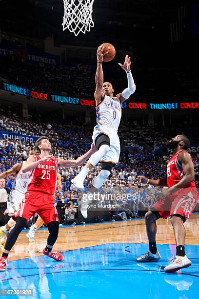Russell Westbrook of the Oklahoma City Thunder drives to the basket against James Harden and Chandler Parsons of the Houston Rockets in Game Two of...