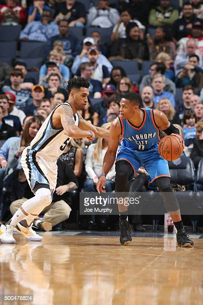 Russell Westbrook of the Oklahoma City Thunder drives to the basket against Mike Conley of the Memphis Grizzlies during the game on December 8 2015...