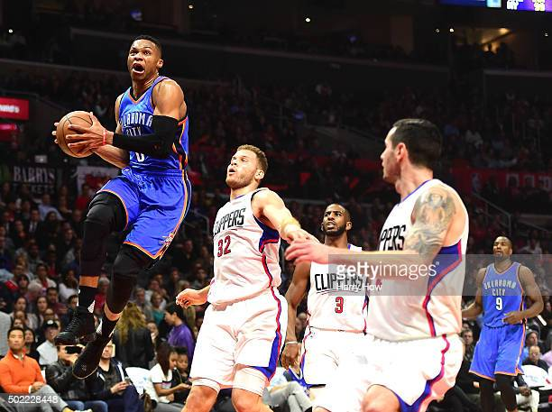 Russell Westbrook of the Oklahoma City Thunder drives to the basket on Blake Griffin Chris Paul and JJ Redick of the Los Angeles Clippers during the...