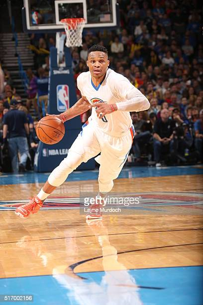 Russell Westbrook of the Oklahoma City Thunder drives to the basket against the Houston Rockets on March 22 2016 at Chesapeake Energy Arena in...
