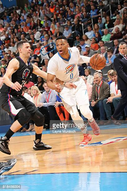 Russell Westbrook of the Oklahoma City Thunder drives to the basket against the Los Angeles Clippers on March 31 2016 at Chesapeake Energy Arena in...