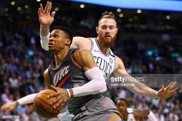 Russell Westbrook of the Oklahoma City Thunder drives to the basket past Aron Baynes of the Boston Celtics during a game at TD Garden on March 20...