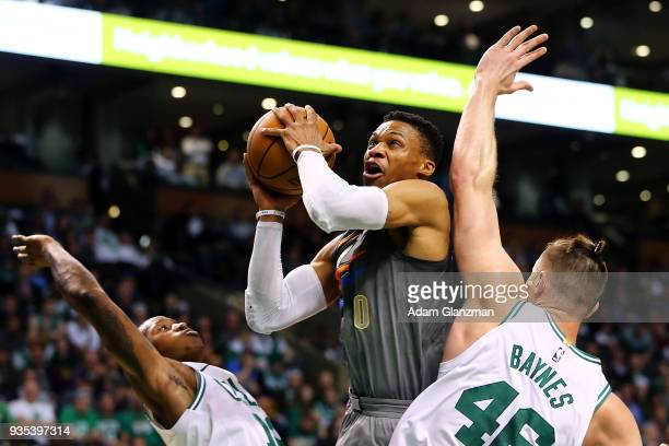Russell Westbrook of the Oklahoma City Thunder drives to the basket past Aron Baynes and Terry Rozier of the Boston Celtics during a game at TD...