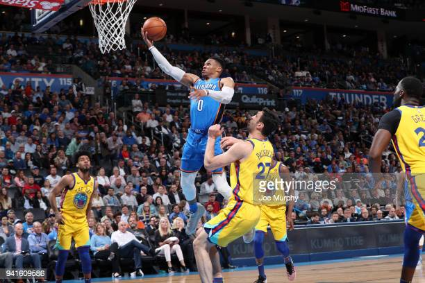 Russell Westbrook of the Oklahoma City Thunder drives to the basket against Zaza Pachulia of the Golden State Warriors during the game on April 3...