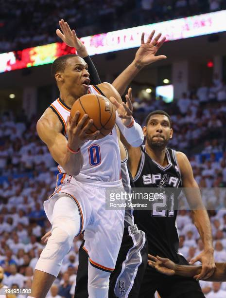 Russell Westbrook of the Oklahoma City Thunder drives with the ball against Tim Duncan of the San Antonio Spurs in the second half during Game Six of...