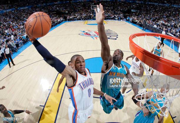 Russell Westbrook of the Oklahoma City Thunder dunks against Emeka Okafor of the New Orleans Hornets on November 29 2010 at the Ford Center in...