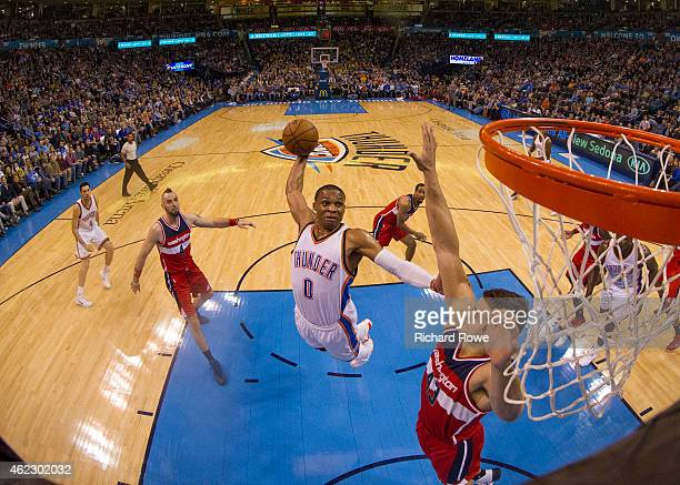 Russell Westbrook of the Oklahoma City Thunder dunks against Kris Humphries of the Washington Wizards at the Chesapeake Energy Arena on January 2...