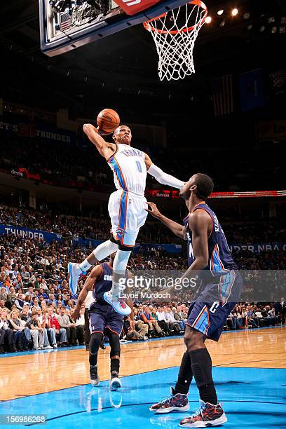 Russell Westbrook of the Oklahoma City Thunder dunks against Michael KiddGilchrist of the Charlotte Bobcats on November 26 2012 at the Chesapeake...
