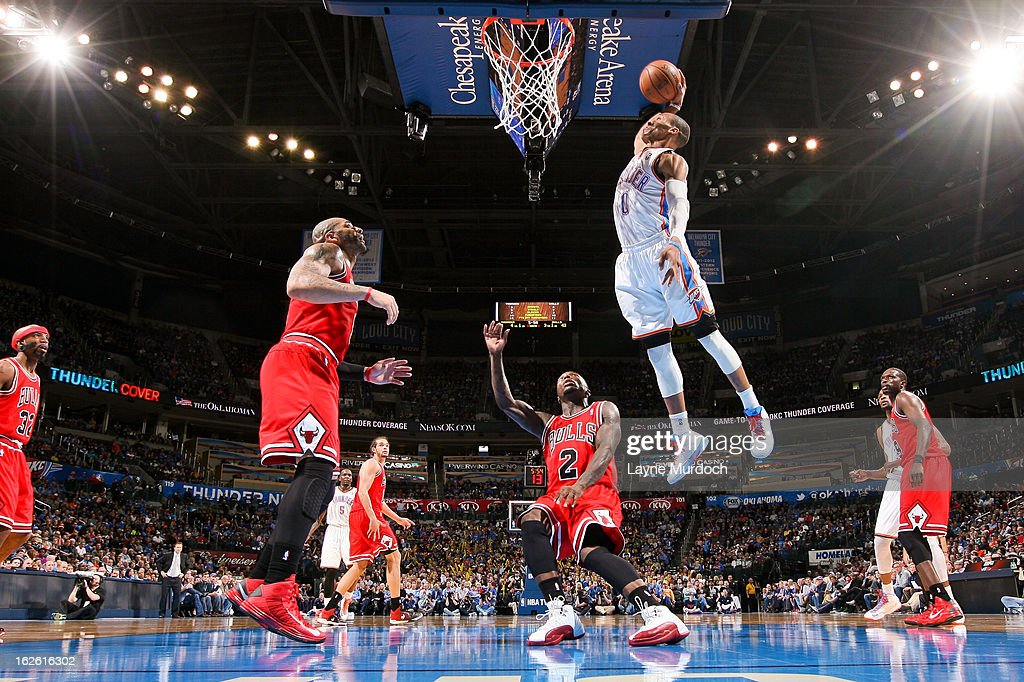 Russell Westbrook #0 of the Oklahoma City Thunder dunks against Nate Robinson #2 of the Chicago Bulls on February 24, 2013 at the Chesapeake Energy Arena in Oklahoma City, Oklahoma.
