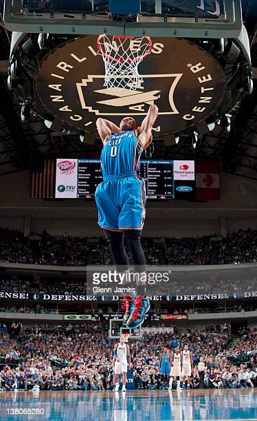 Russell Westbrook of the Oklahoma City Thunder dunks against the Dallas Mavericks on February 1 2012 at the American Airlines Center in Dallas Texas...
