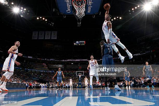Russell Westbrook of the Oklahoma City Thunder dunks against the Minnesota Timberwolves on March 13 2015 at the Chesapeake Energy Arena in Oklahoma...