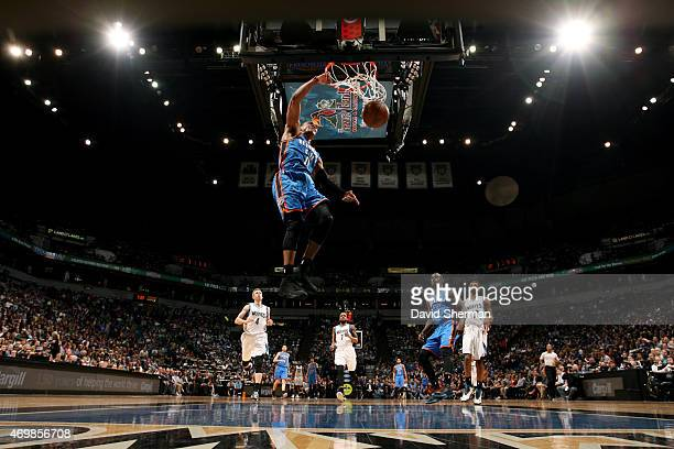 Russell Westbrook of the Oklahoma City Thunder dunks against the Minnesota Timberwolves on April 15 2015 at Target Center in Minneapolis Minnesota...