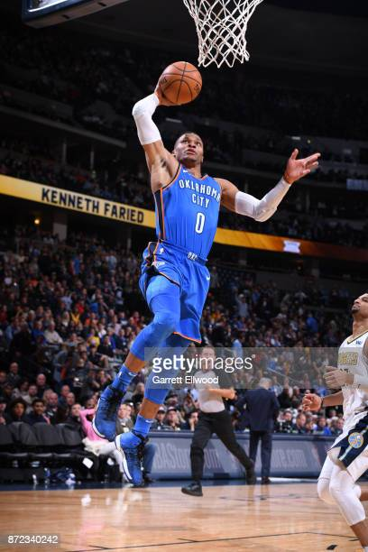 Russell Westbrook of the Oklahoma City Thunder dunks against the Denver Nuggets on November 9 2017 at the Pepsi Center in Denver Colorado NOTE TO...