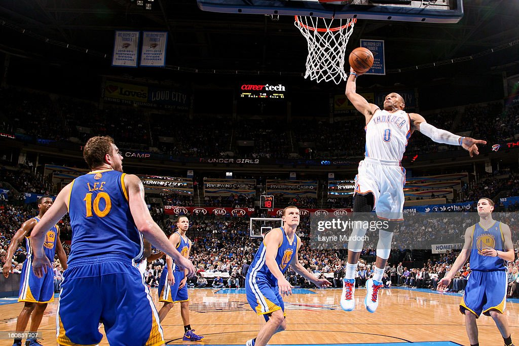 Russell Westbrook #0 of the Oklahoma City Thunder dunks against the Golden State Warriors on February 6, 2013 at the Chesapeake Energy Arena in Oklahoma City, Oklahoma.