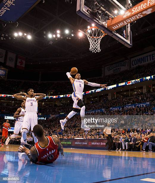 Russell Westbrook of the Oklahoma City Thunder dunks against the Portland Trail Blazers at the Chesapeake Energy Arena on December 23 2013 in...