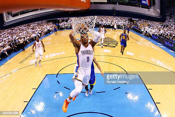 Russell Westbrook of the Oklahoma City Thunder dunks against the Golden State Warriors in the first half in game four of the Western Conference...