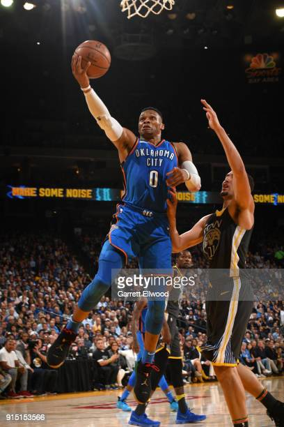 Russell Westbrook of the Oklahoma City Thunder dunks against the Golden State Warriors on February 6 2018 at ORACLE Arena in Oakland California NOTE...