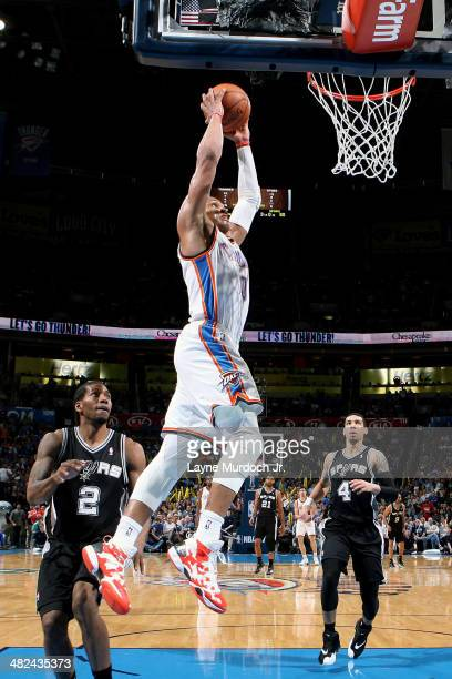 Russell Westbrook of the Oklahoma City Thunder dunks against the San Antonio Spurs on April 03 2014 at the Chesapeake Energy Arena in Oklahoma City...