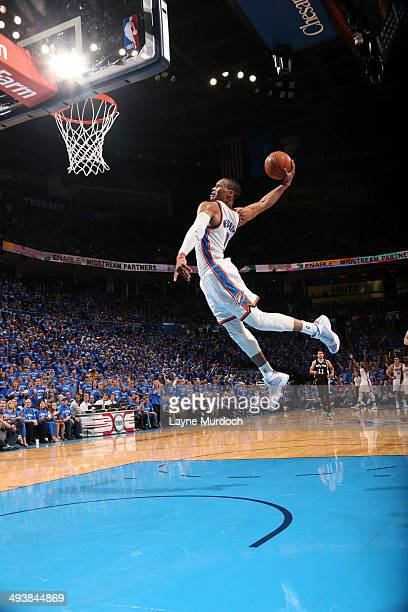 Russell Westbrook of the Oklahoma City Thunder dunks against the San Antonio Spurs in Game Three of the Western Conference Finals during the 2014 NBA...
