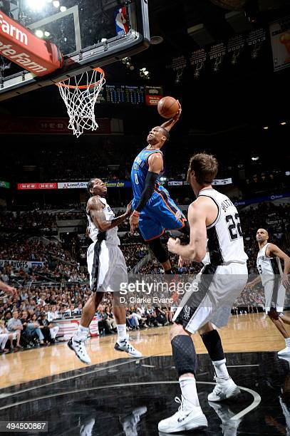 Russell Westbrook of the Oklahoma City Thunder dunks against the San Antonio Spurs in Game Five of the Western Conference Finals during the 2014 NBA...