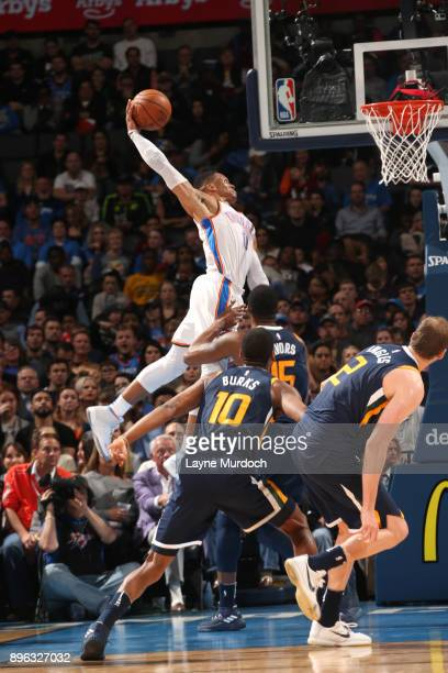 Russell Westbrook of the Oklahoma City Thunder dunks against the Utah Jazz on December 20 2017 at Chesapeake Energy Arena in Oklahoma City Oklahoma...