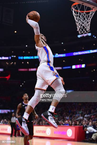 Russell Westbrook of the Oklahoma City Thunder dunks during the first half against the LA Clippers at Staples Center on January 4 2018 in Los Angeles...
