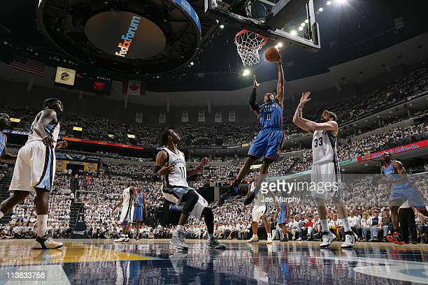 Russell Westbrook of the Oklahoma City Thunder dunks over Marc Gasol of the Memphis Grizzlies in Game Three of the Western Conference Semifinals...