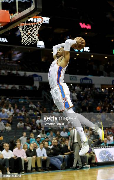 Russell Westbrook of the Oklahoma City Thunder dunks the ball against the Charlotte Hornets during their game at Spectrum Center on November 1 2018...