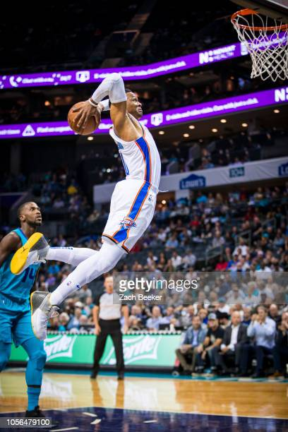 Russell Westbrook of the Oklahoma City Thunder dunks the ball against the Charlotte Hornets on November 1 2018 at Spectrum Center in Charlotte North...