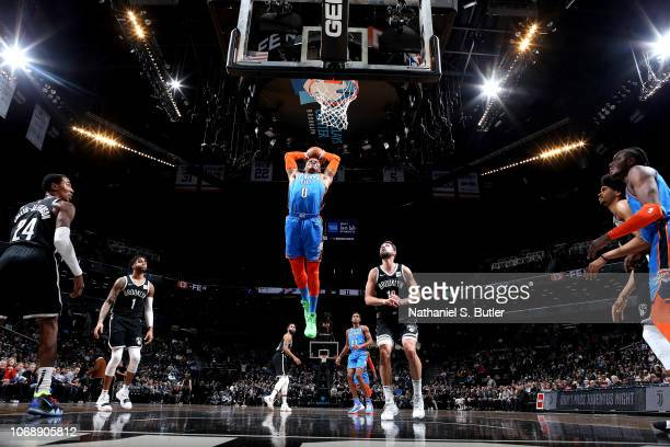 Russell Westbrook of the Oklahoma City Thunder dunks the ball against the Brooklyn Nets on December 5 2018 at Barclays Center in Brooklyn New York...