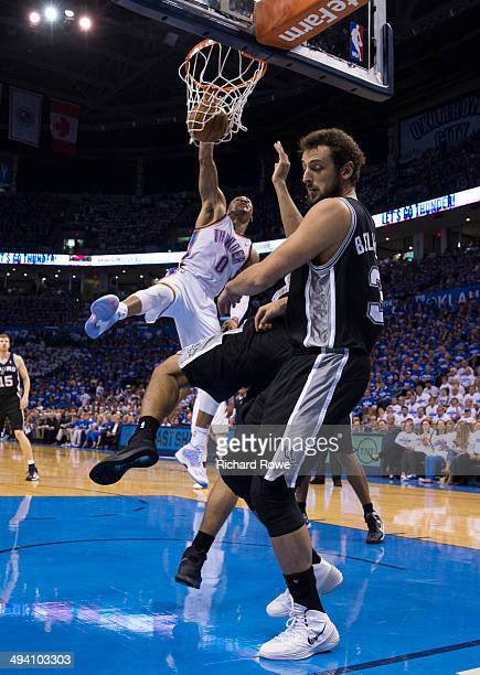 Russell Westbrook of the Oklahoma City Thunder dunks the ball against the San Antonio Spurs in Game 4 of the Western Conference Finals during the...