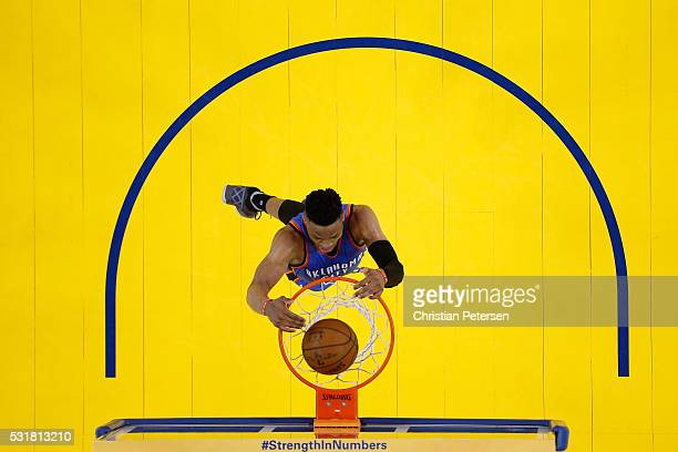 Russell Westbrook of the Oklahoma City Thunder dunks the ball against the Golden State Warriors during game one of the NBA Western Conference Final...
