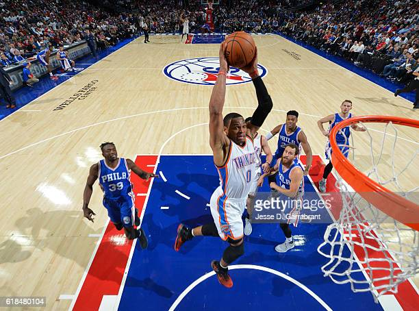 Russell Westbrook of the Oklahoma City Thunder dunks the ball against Philadelphia 76ers during game at the Wells Fargo Center on October 26 2016 in...