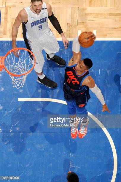 Russell Westbrook of the Oklahoma City Thunder dunks the ball against the Orlando Magic on November 29 2017 at Amway Center in Orlando Florida NOTE...