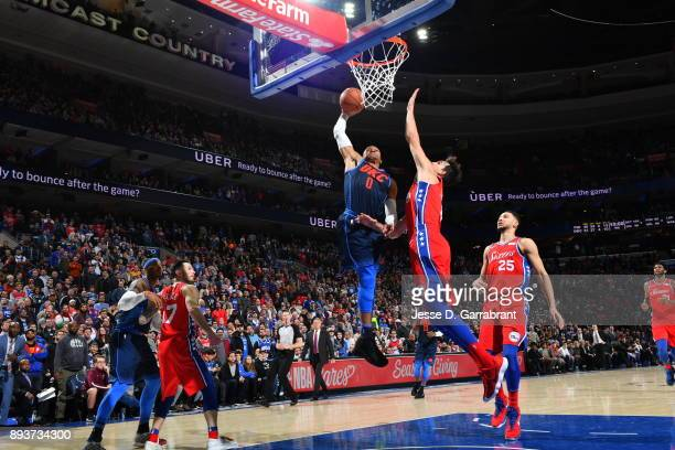 Russell Westbrook of the Oklahoma City Thunder dunks the ball against the Philadelphia 76ers at Wells Fargo Center on December 15 2017 in...