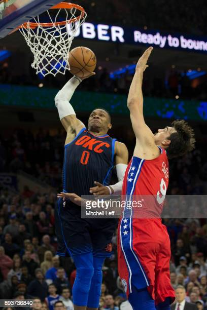 Russell Westbrook of the Oklahoma City Thunder dunks the ball against Dario Saric of the Philadelphia 76ers in triple overtime at the Wells Fargo...
