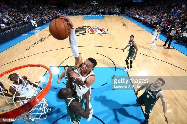 Russell Westbrook of the Oklahoma City Thunder dunks the ball against the Milwaukee Bucks on December 29 2017 at Chesapeake Energy Arena in Oklahoma...