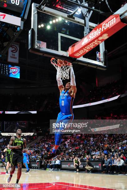 Russell Westbrook of the Oklahoma City Thunder dunks the ball against the Atlanta Hawks on March 13 2018 at Philips Arena in Atlanta Georgia NOTE TO...