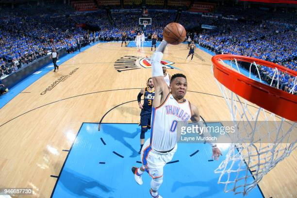 Russell Westbrook of the Oklahoma City Thunder dunks the ball against the Utah Jazz during Game One of Round One of the 2018 NBA Playoffs on April 15...