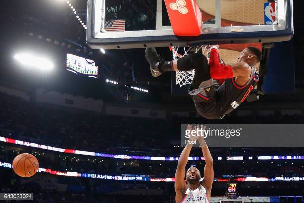 Russell Westbrook of the Oklahoma City Thunder dunks the ball as Kemba Walker of the Charlotte Hornets reacts in the first half of the 2017 NBA...